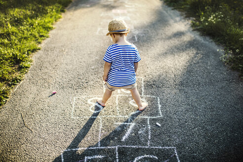 Back view of toddler boy playing Hopscotch - HAPF02753
