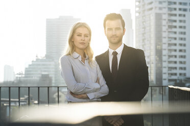 Portrait of businesswoman and businessman on rooftop - SBOF01528