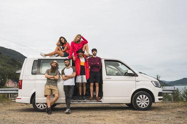 Friends traveling through Norwegian lapland with a camping van - KKAF02055