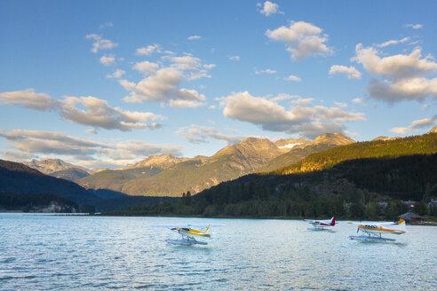 Three seaplanes moored on Green Lake, Whistler, British Columbia, Canada - AURF07307