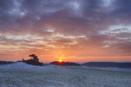 Germany, Bavaria, Sunrise over rural landscape with fields and forest in winter - RUEF01981