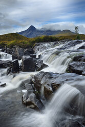 United Kingdom, Scotland, Scottish Highlands, Isle Of Skye, Waterfall at Sligachan river with view to the Cuillin mountains - RUEF02005