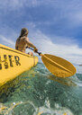 Woman kayaking in tropical waters, Tambon Ko Tarutao, Chnag Wat Krabi, Thailand - AURF07606