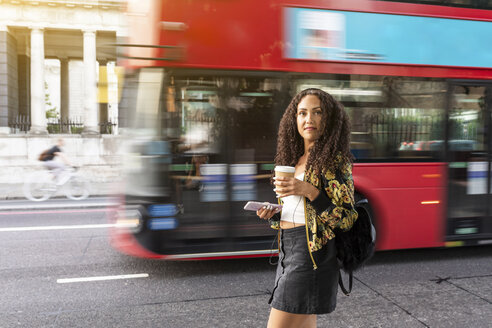UK, London, young woman on the move in the city - WPEF00828