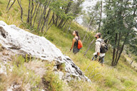 Italy, Massa, young couple hiking in the Alpi Apuane mountains - WPEF00832
