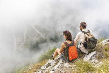 Italy, Massa, couple looking at the beautiful view in the Alpi Apuane - WPEF00865
