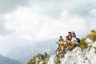 Italy, Massa, group of people hiking and looking at a map in the Alpi Apuane - WPEF00877