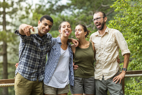Italy, Massa, friends taking a funny selfie together outdoors - WPEF00895