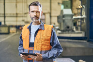 Portrait of man holding tablet in factory - BSZF00602