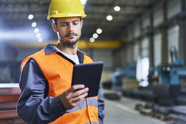Man using tablet in factory - BSZF00620