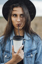 Portrait of young woman drinking beverage - VPIF00894