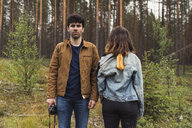 Finland, Lapland, man with camera and woman standing in rural landscape - KKAF02087