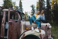 Two friends sitting on a broken truck - KKAF02208