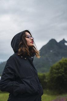 Portrait of a woman wearing hooded jacket, outdoors - KKAF02274