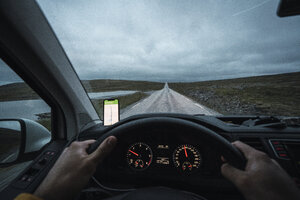 Young man driving car in Lapland, Norway - KKAF02304