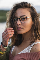 Portrait of beautiful young woman wearing glasses - KKAF02331