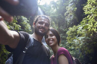Spain, Canary Islands, La Palma, smiling couple taking a selfie in a forest - PACF00168