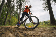 Athlete mountainbiking in the woods - KKAF02373