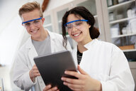Students using digital tablet in laboratory - CUF44179
