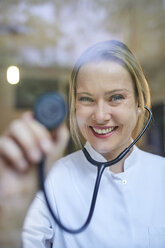 Portrait of smiling female doctor holding stethoscope - PNEF00992