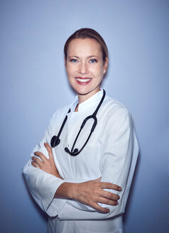 Portrait of smiling female doctor with stethoscope - PNEF01001