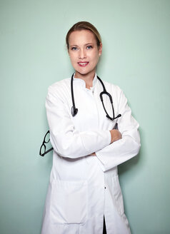 Portrait of confident female doctor with stethoscope - PNEF01004