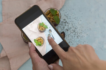 Woman's hand taking photo of dessert with smartphone, close-up - JUNF01361