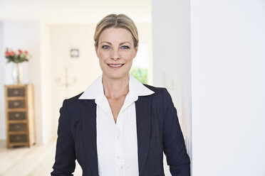 Portrait of smiling businesswoman at home - PDF01767