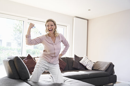 Portrait of exuberant woman posing on couch at home - PDF01782