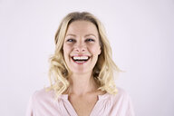 Portrait of laughing blond woman - PDF01788