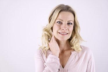 Portrait of smiling blond woman - PDF01791