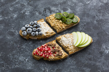 Bread slices with various toppings - JUNF01413