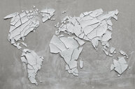 Clay shards forming world map, broken, concept ecological disasters - AS06234