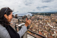 Woman enjoying view from top of Dome Church, Florence, Tuscany, Italy - CUF44243