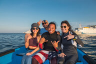 Divers enjoying dive boat trip, Tubbataha Reefs Natural Park, Sulu Sea, Philippines - CUF44285