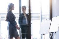 Businesswomen discussing ideas in office - CUF44339