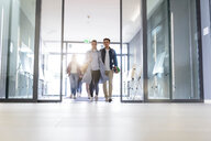 Students entering college building by glass doors - CUF44345