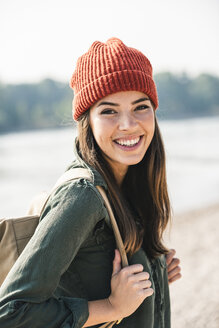 Portrait of smiling young woman at the riverside - UUF15337