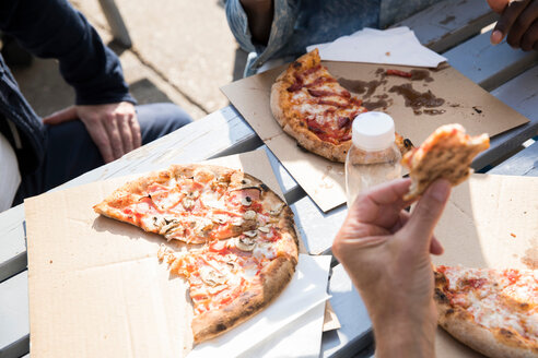 Friends having pizza outdoors - CUF44473