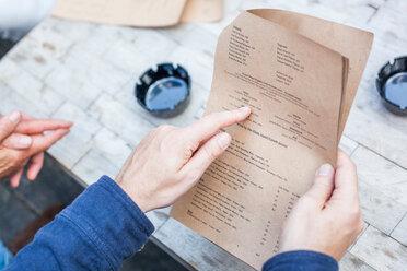 Man pointing at menu - CUF44479
