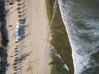 Indonesia, Bali, Aerial view of Balangan beach, sunloungers and beach umbrellas - KNTF02048