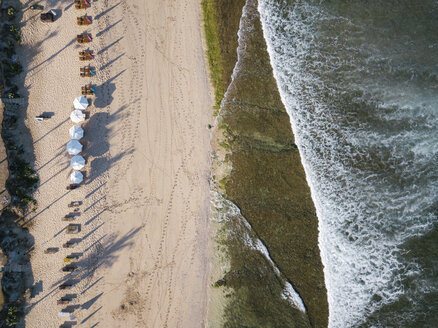 Indonesia, Bali, Aerial view of Balangan beach, sunloungers and beach umbrellas - KNTF02048