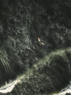 Indonesia, Bali, Aerial view of surfer at Yeh Gangga beach - KNTF02072