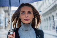 Woman with umbrella on morning commute, Budapest, Hungary - CUF44722