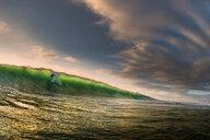 Surfer surfing on barreling wave, Crab Island, Doolin, Clare, Ireland - CUF44821