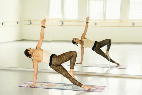 Woman practising yoga in studio - CUF45004