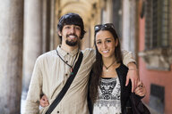 Italy, Bologfna, portrait of happy young couple arm in arm - GIOF04667