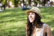 Portrait of happy young woman in a park watching something - GIOF04688