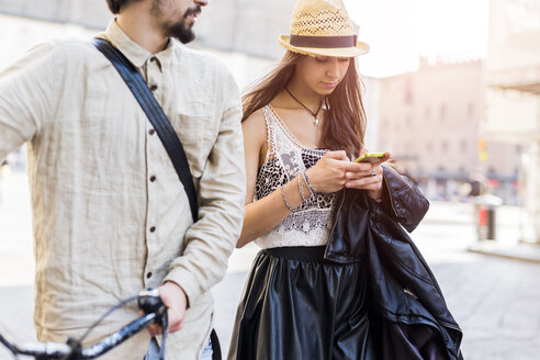 Young woman using smartphone in the city - GIOF04709