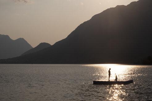 Austria, Ausseer Land, People at lake having fun on a floating platform - HAMF00380